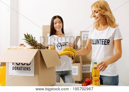 Scrupulous work. Dedicated capable intelligent women making sure they not missing anything while packing boxes and shipping them to those in need