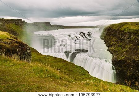 Gullfoss waterfall in Golden Circle popular tourist route in the canyon of the Hvítá river in southwest Iceland.Long exposure panorama of beautiful popular iconic Gullfoss cascade fall.
