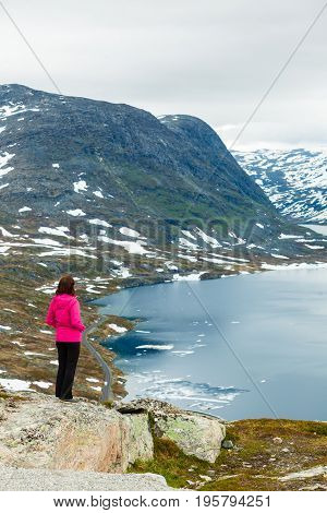 Tourist Woman Standing By Djupvatnet Lake, Norway