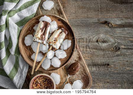 Homemade cream ice cream with chocolate and muesli