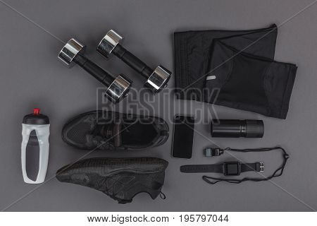 Flat Lay With Sportswear, Fitness Equipment And Gadgets Isolated On Grey