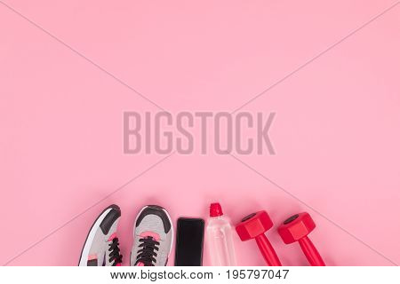 Top View Of Smartphone With Blank Screen And Fitness Equipment Isolated On Pink