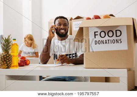 You are very welcome. Handsome sincere motivated guy working for charitable organization and sending foods to those in need while calling someone from office