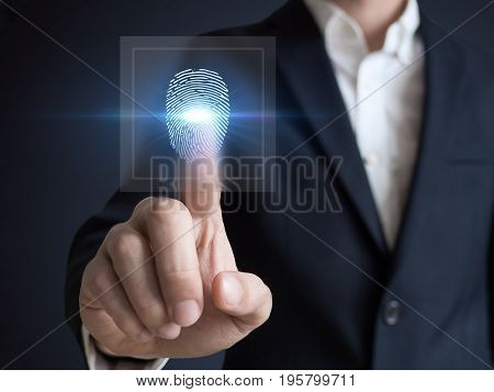 Businessman pressing modern technology display panel fingerprint