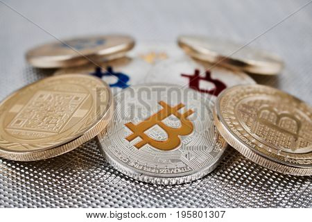 Colorful Bitcoins On Silver Background