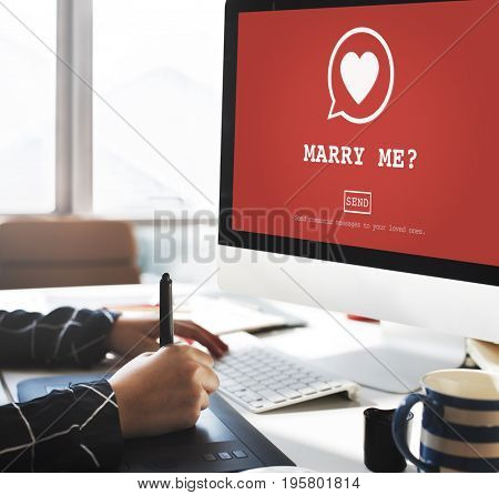 Marry Me heart graphic on computer screen