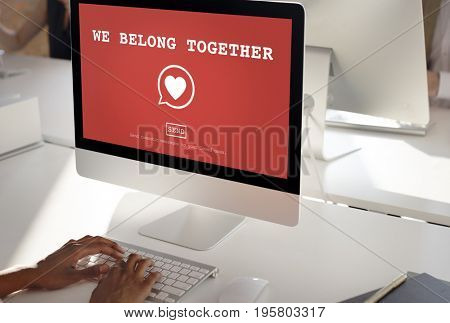 We Belong Together text on red computer screen