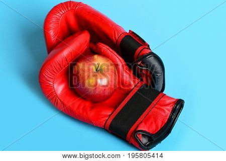 Training And Fitness Concept. Boxing Gloves With Red Apple