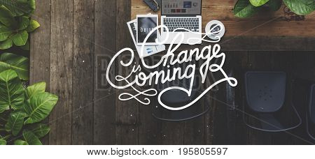 Change is coming text on wooden background