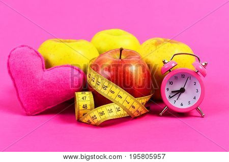 Clock, Heart And Tape Measure Belted Around Red Apple