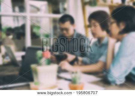 Executive Having Casual Discussion In Office. Partners In Casual Clothes Discussing The Strategy And