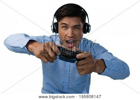 Businessman making face while playing video game against white background