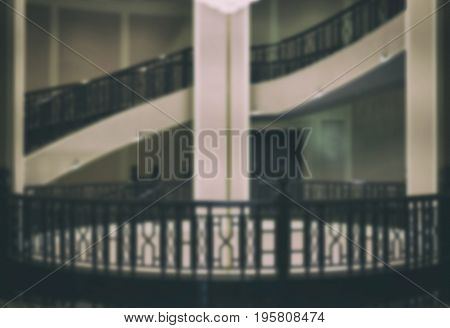 Elegant Stairway Interior Architecture. Circular Wood Classic Staircase. Blur Image For Background