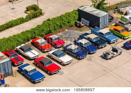 BERLIN, GERMANY - JUNE 15, 2017: American vintage cars on the parking in Berlin, Germany. Berlin is the capital and the largest city of Germany with a population of approximately 3.7 million people.