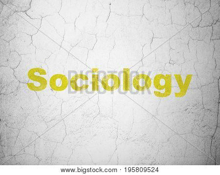 Education concept: Yellow Sociology on textured concrete wall background