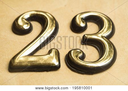 Close up of Gold Numeral Character Sign