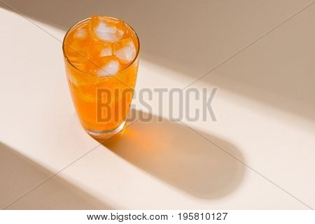 Soft drinks. Orange soda on table with back light.