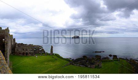 Tantallon Castle and Bass Rock off the coast in Scotland.