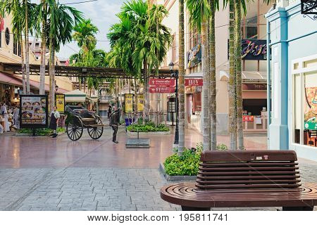Bangkok, Thailand - January 9, 2016: Rickshaw statue decorated at the entrance of Asiatique Riverfront Factory District. Asiatique is largest lifestyle shopping mall in Bangkok