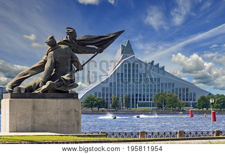RIGA, LATVIA - JULY 16, 2017: Embankment of Daugava river in center of Riga - the capital and largest city of Latvia, a major commercial, cultural, historical and financial center of the Baltic region