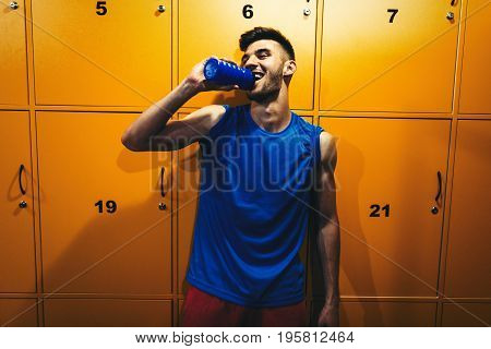 Portrait of young handsome man in locker room