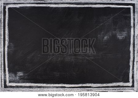 Chalk rubbed out on blackboard. Abstract background empty template.