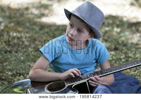 He Is Having Fun While Learning To Play Guitar