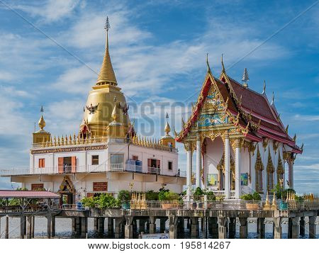 Bang Pakong Thailand - July 16 2017: Wat Hong Thong a temple built on a concrete platform at the coast of Chachoensao in Thailand after the sea started to reclaim the area of the original temple several decades ago as a result of erosion.