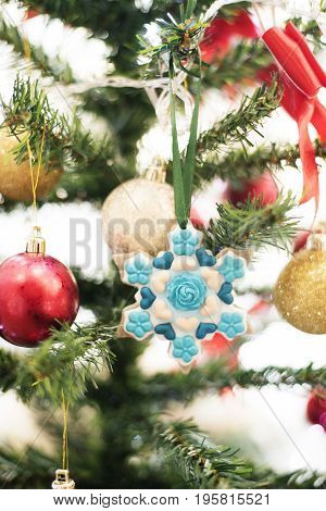 A Close-up View Of A Decorated Christmas Tree With Snowflake And Xmas Balls