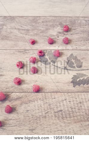Raspberries On A Wooden Background. Vintage Tinted, Filter. Copy Space
