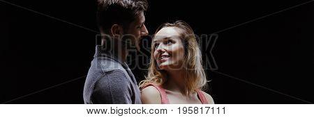 Romantic Man Embracing Smiling Woman