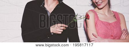 Man Touching Woman With Rose