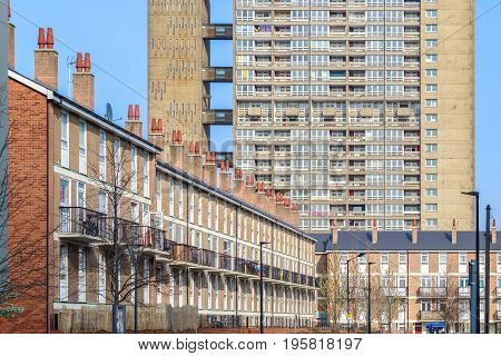 English Terraced Houses In Contrast To Council Housing Block In The Background
