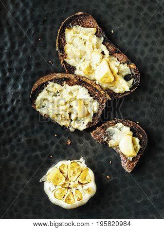 close up of rustic aromatic garlic jam toast