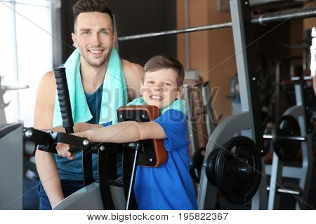 Dad and son training in gym