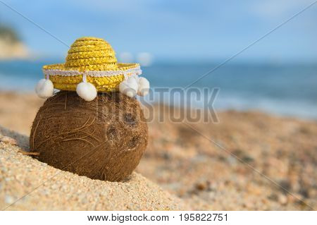 Tropical coconut at the Spanish beach with yellow sombrero