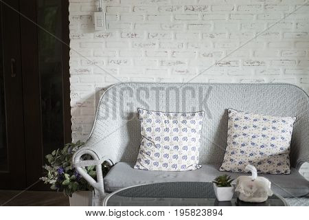 Blue Rattan Sofa With Pillow In Living Room In Modern House. Home Interior Design