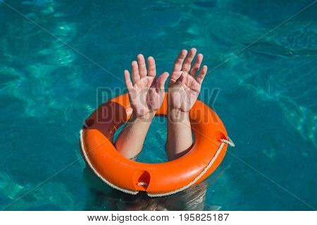 Close up of man hands through lifebelt in sea. Emergency drowning help concept