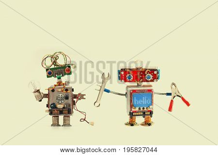 Robots fix service concept. Hand wrench pliers handyman, funny cyborg with lamp bulb electric wire. Yellow background.
