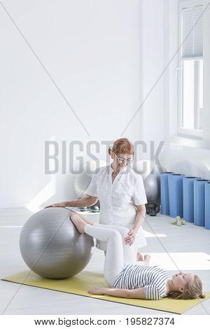 Little Girl Exercising On Ball