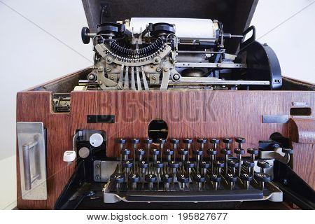 Antique typewriter/telex machine build in wooden box