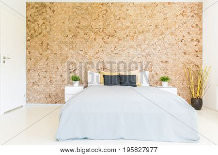 Bedroom With Wooden Mosaic Wall