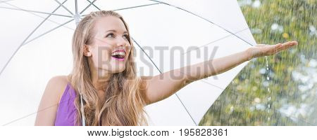 Blonde Girl Checking If It Still Rains During Stroll