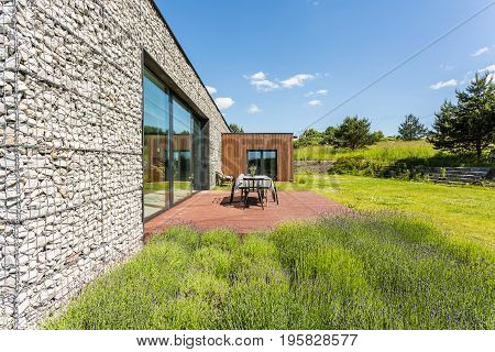 Pebble Wall House With Terrace