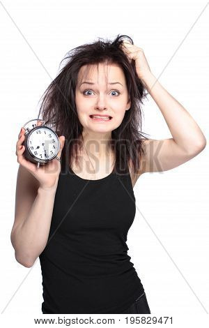 stressed young woman with clock on white background