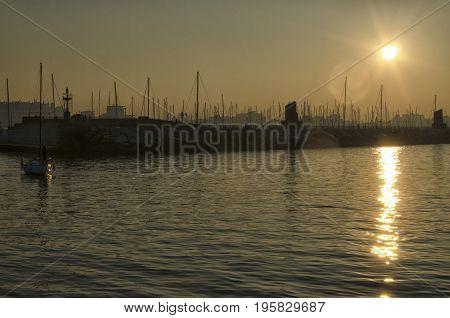 View of sundown over the marina of Rimini
