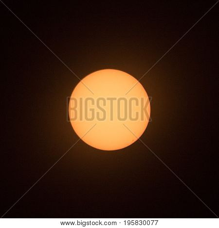 Sun with sunspot at 4 o'clock position