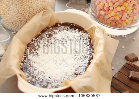 Baking dish with delicious rice dessert on table