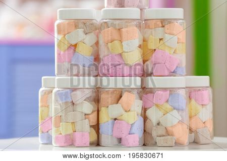 Tasty marshmallow in jars at candy shop