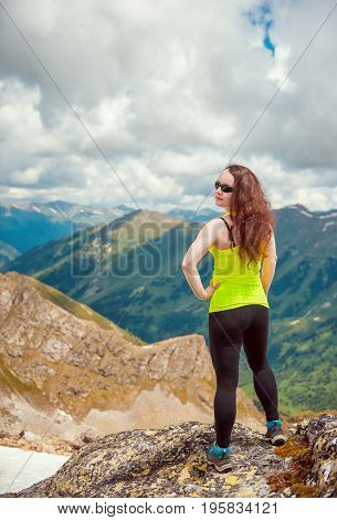 Woman Hiker Standing On The Top Of Mountain